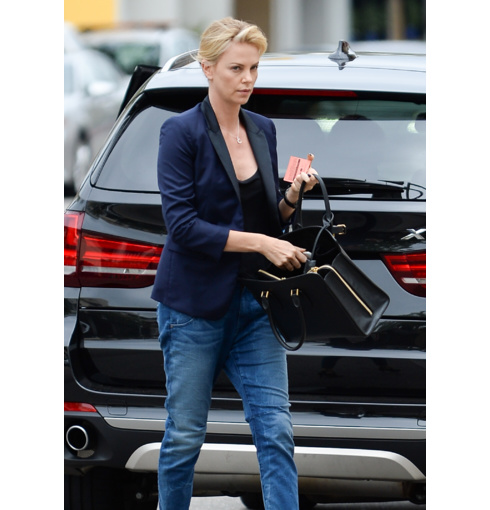 Charlize Theron wears Monica Vinader Alphabet pendant